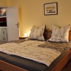 Apartment Erde - Schlafzimmer
